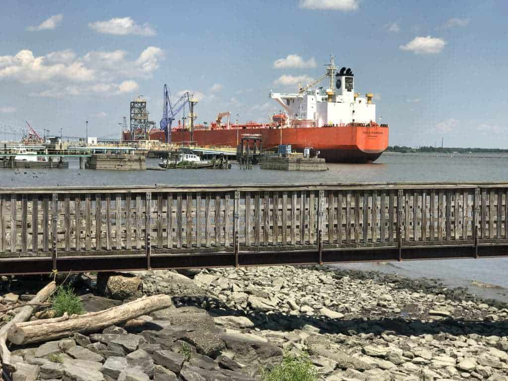A cargo ship berthed at Monroe Energy dock, seen from Marcus Hook's Riverside Park. PHOTO BY MEG MCGUIRE
