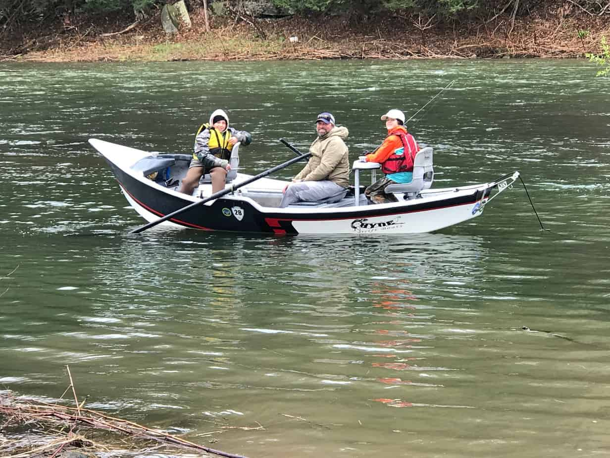 A drift boat close to the bank, with Guide Matt Ertzinger in the middle, with Max Kennedy and Elijah Odell - two students from the Bill Canfield Fly Fishing School, hosted by FUDR in the summer. PHOTO BY MEG MCGUIRE