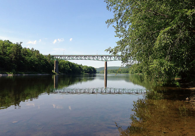 The Delaware River just rolls along, moving south from the site of the Montague gage. PHOTO BY MEG MCGUIRE